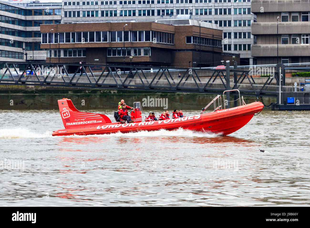 Red high speed 'London RIB Voyages' sightseeing boat on the River Thames at Blackfriars, London, UK - Stock Image