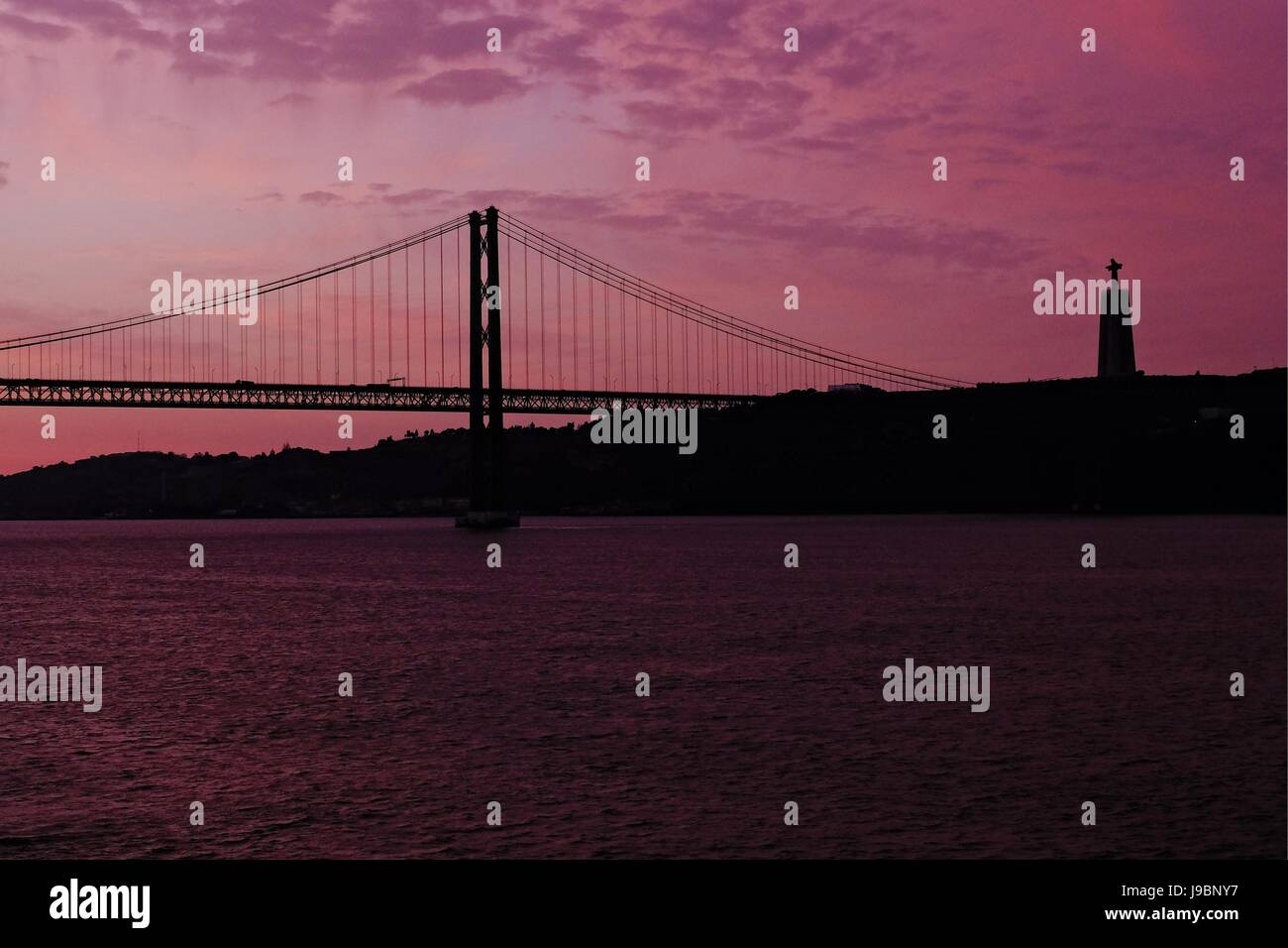 Lisbon - 25 de Abril Bridge and The Sanctuary of Christ the King Monument Stock Photo