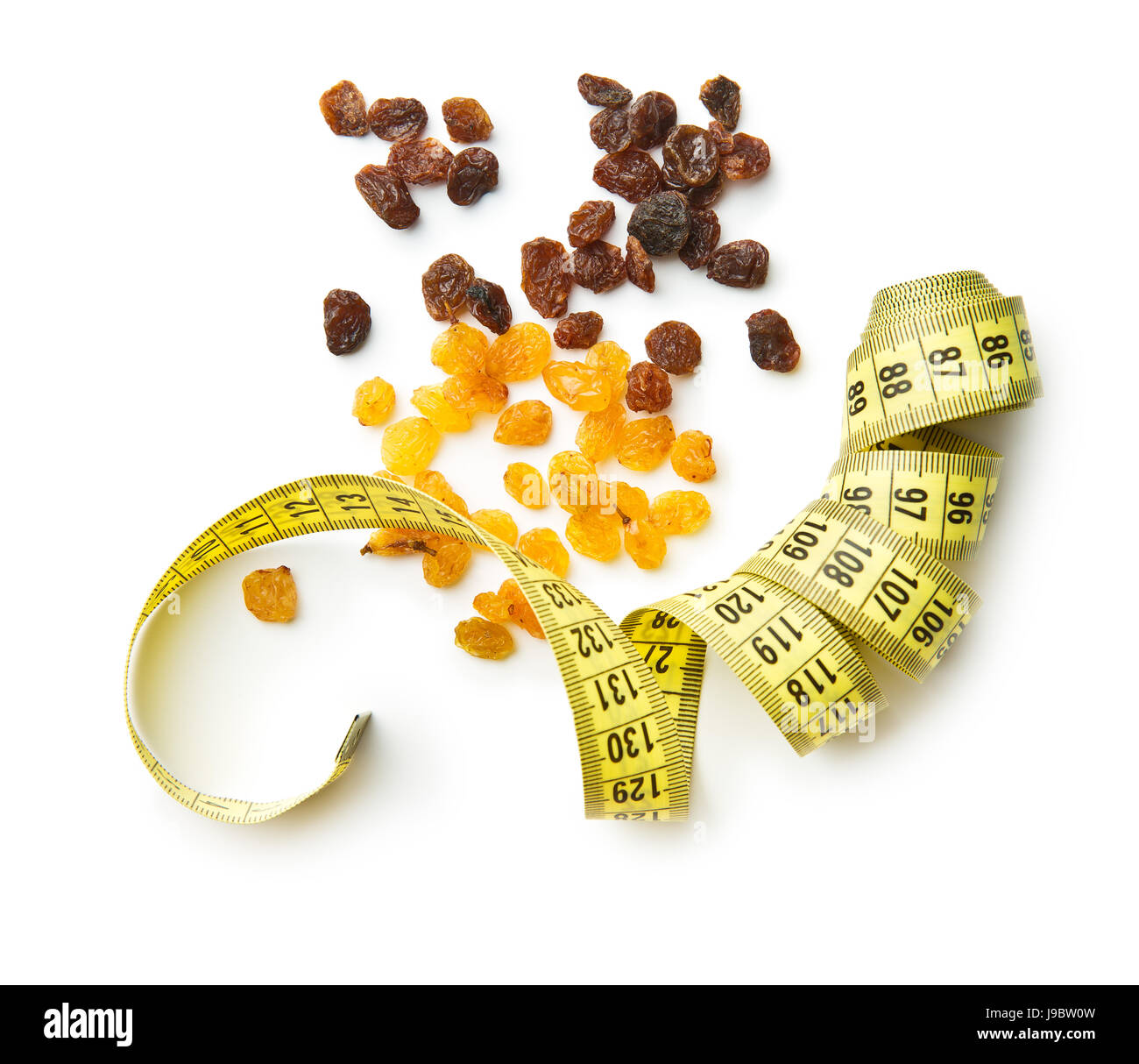 Sweet dried raisins and measuring tape iolated on white background. Top view. - Stock Image