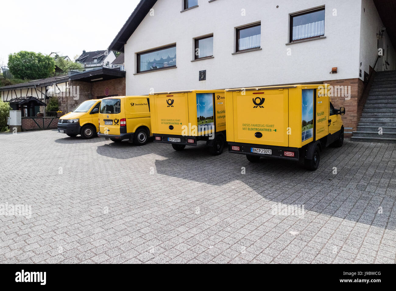 "Two ""Streetscooter"" - electric car with square box from Deutsche Post DHL - Nettersheim, North Rhine Westphalia, Stock Photo"