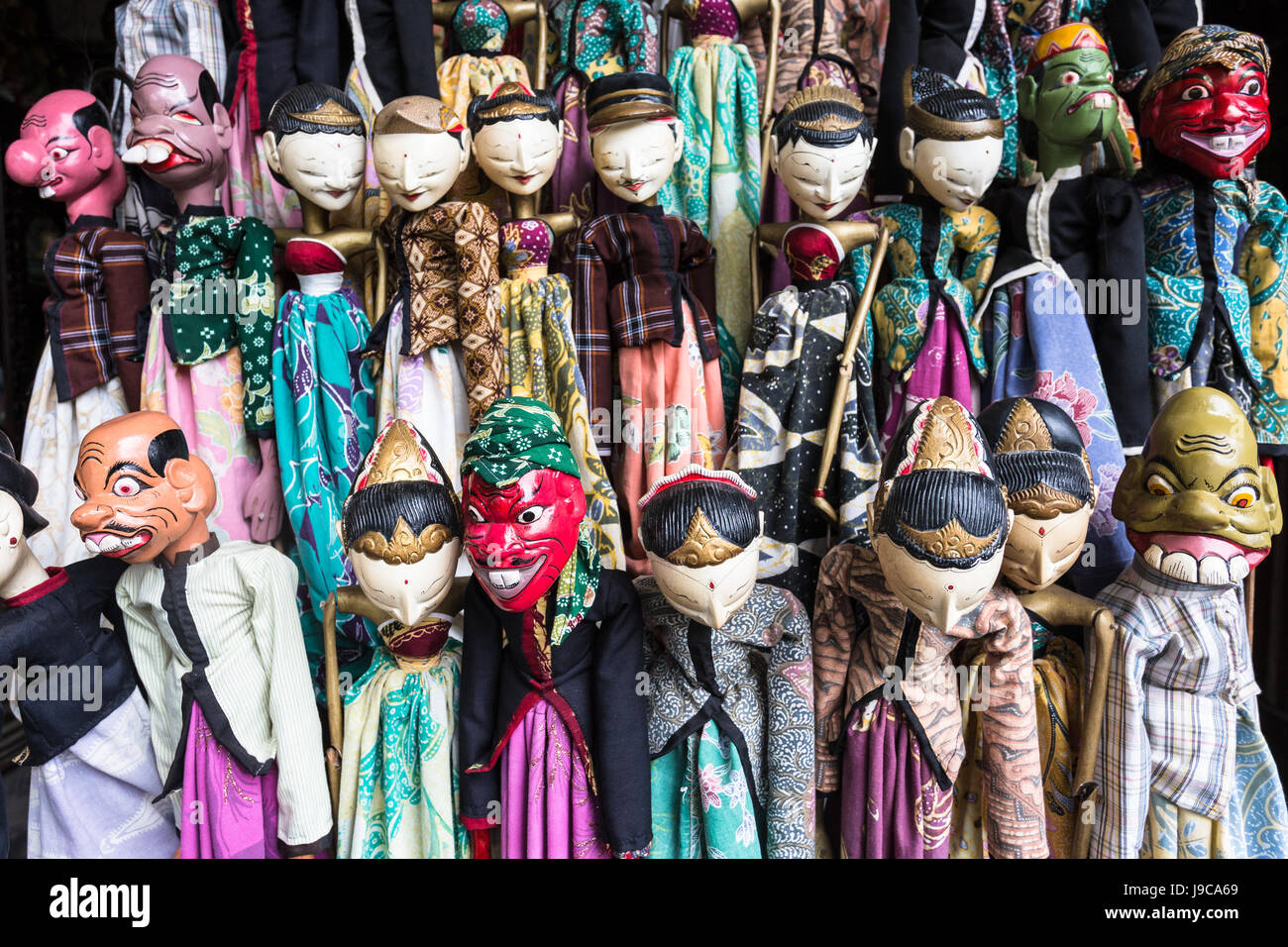 Traditional Javanese wooden puppets called Wayang display in the Jalan Surabaya flea market in Jakarta, Indonesia - Stock Image