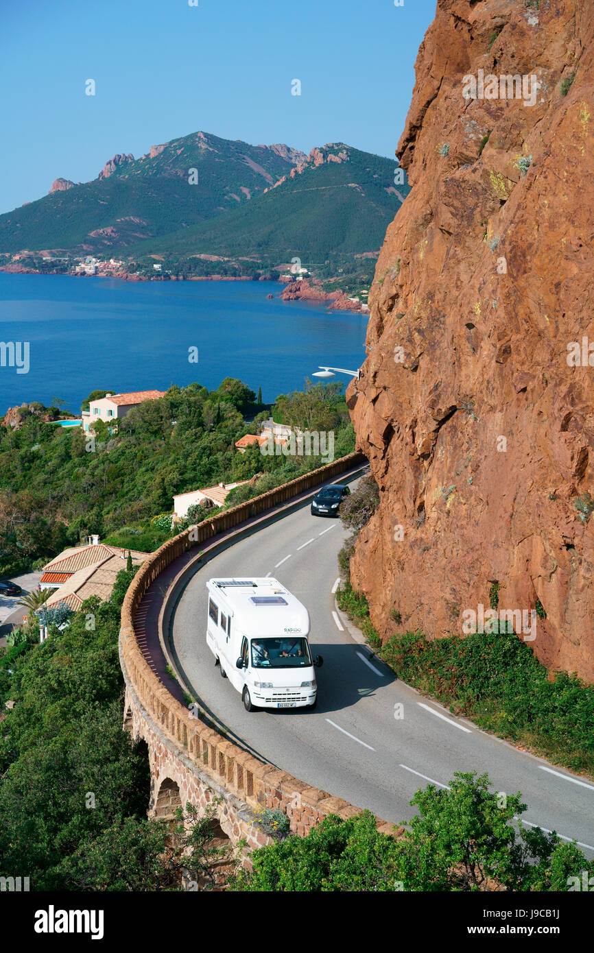 RECREATIONAL VEHICLE CRUISING ON A SCENIC BYWAY. Théoule-sur-Mer, Esterel Massif, Alpes-Maritimes, French Riviera, - Stock Image