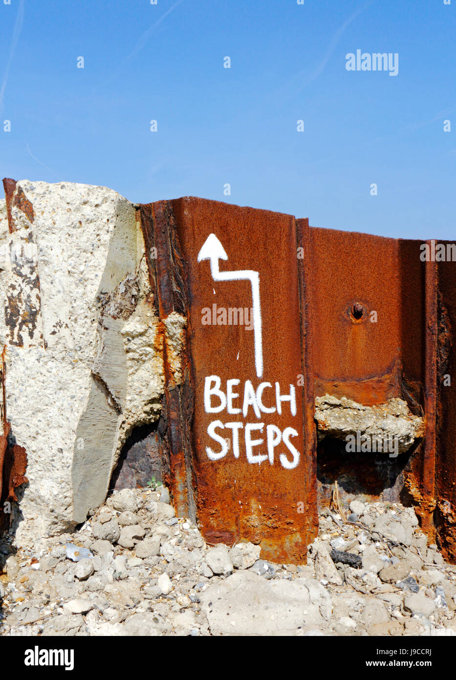 A temporary notice directing beachgoers to steps over sea defences at Mundesley-on-Sea, Norfolk, England, United Stock Photo