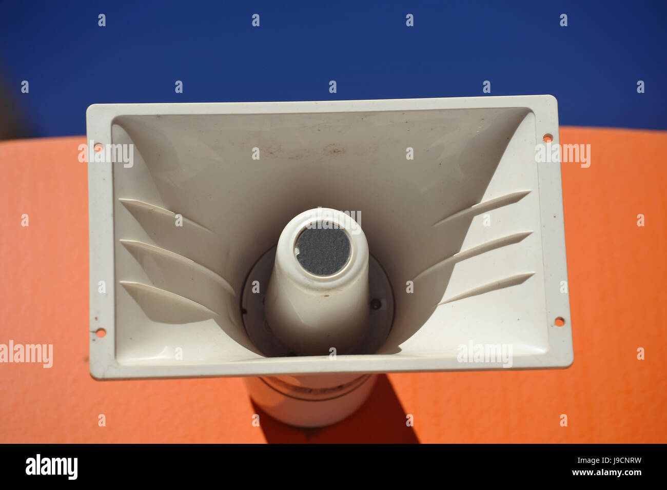 Outdoor Public Address Speaker Mounted to the top of a Railroad Train Car - Stock Image