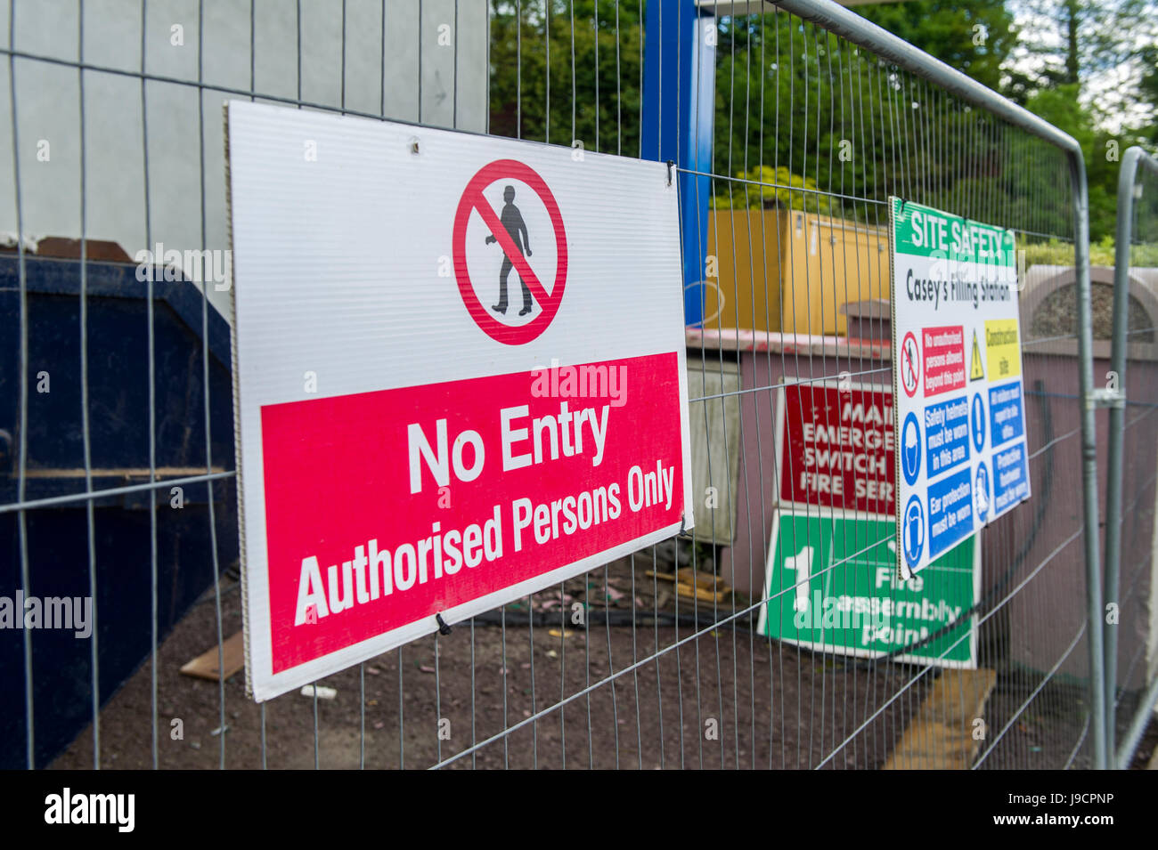 No Entry and warning signs on a metal fence on a building site. - Stock Image