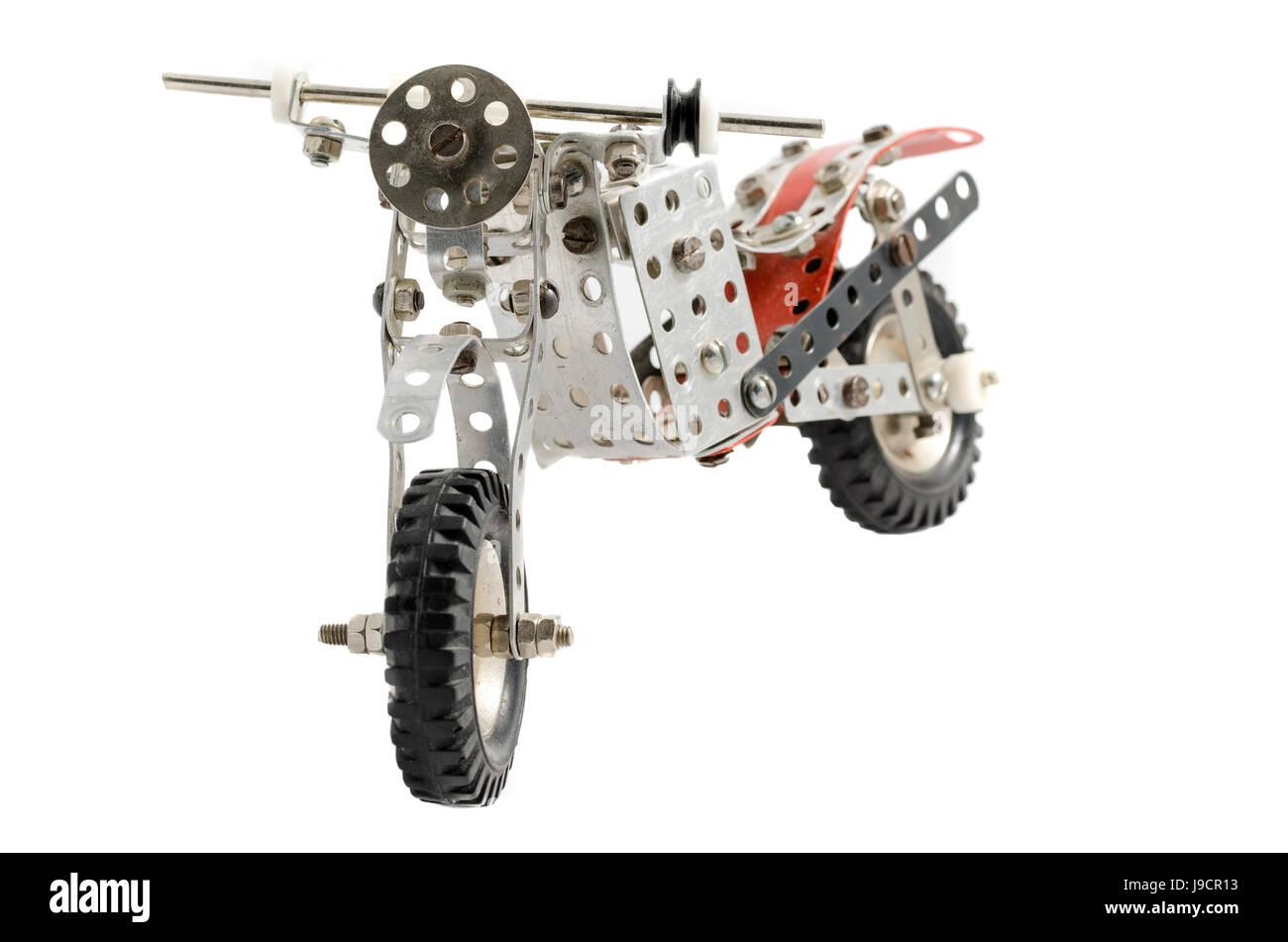 Toy old vintage motorbike isolated on white background Stock Photo