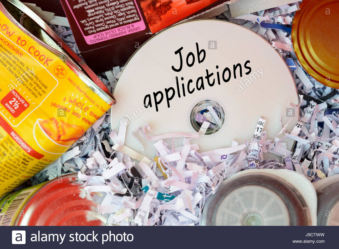 Job applications, data disc thrown in Bin, Dorset, England. Stock Photo