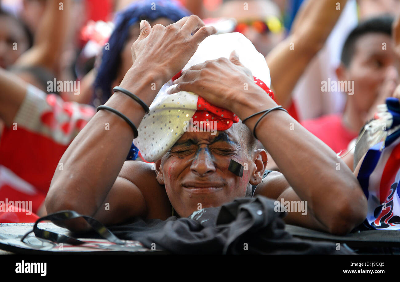 A Costa Rica fan cringes in San José's Plaza de la Democracía as the Costa national team take on the Netherlands Stock Photo