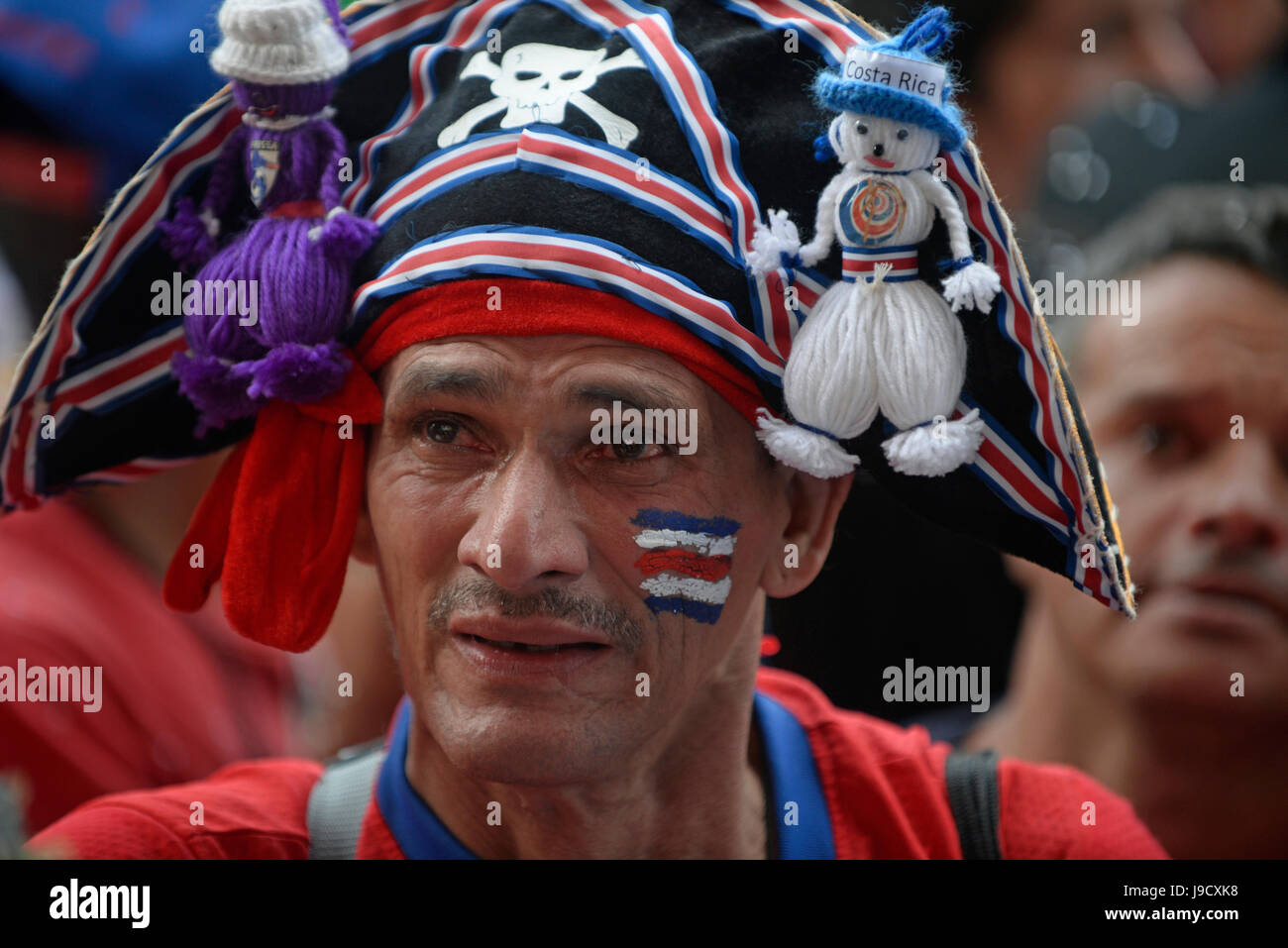 A Costa Rica fan cries in San José's Plaza de la Democracía after the Costa national team's loss to the NetherlandsStock Photo