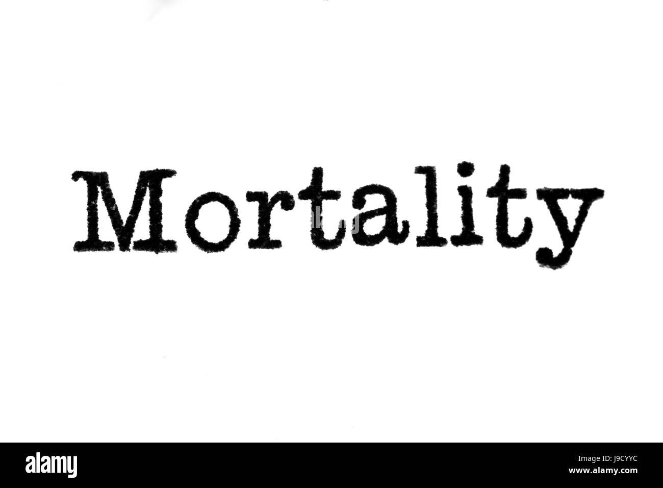The word 'Mortality' from a typewriter on a white background - Stock Image