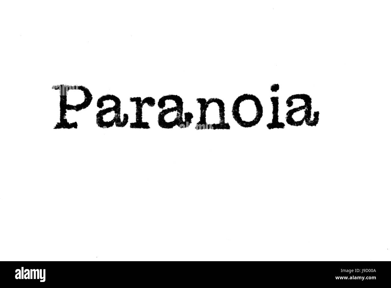 The word 'Paranoia' from a typewriter on a white background - Stock Image