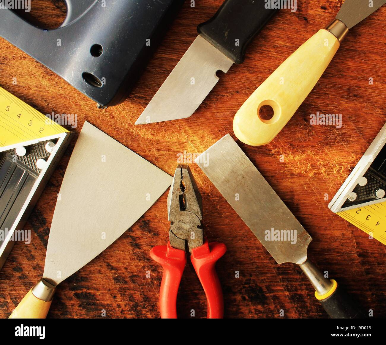 Assorted work tools on wooden background. Top view - Stock Image