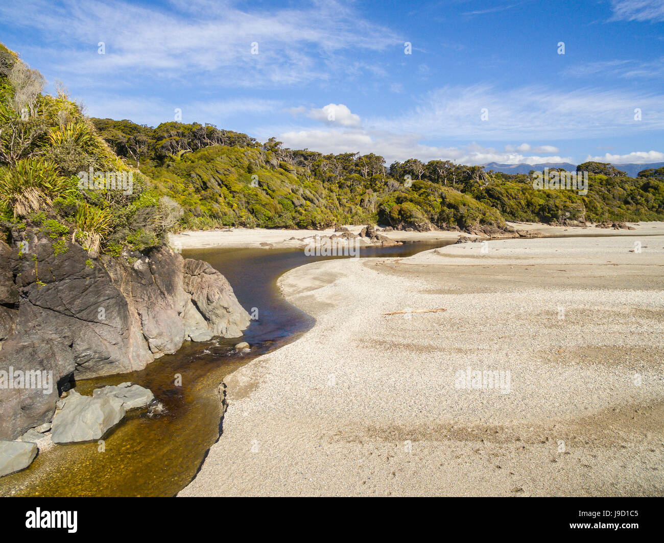 Beach with marshy river, Ship Creek, Haast, West Coast, New Zealand - Stock Image