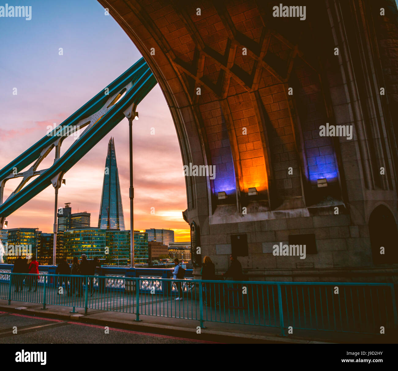 Tower Bridge, view through the gate on The Shard, at sunset, Southwark, London, England, United Kingdom - Stock Image