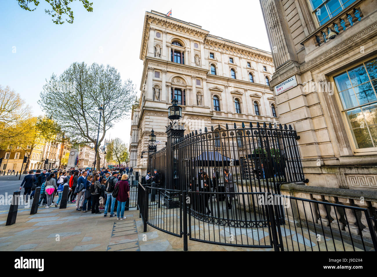 Barricade, police and tourists at the entrance to Downing Street, government district, London, England, United Kingdom - Stock Image