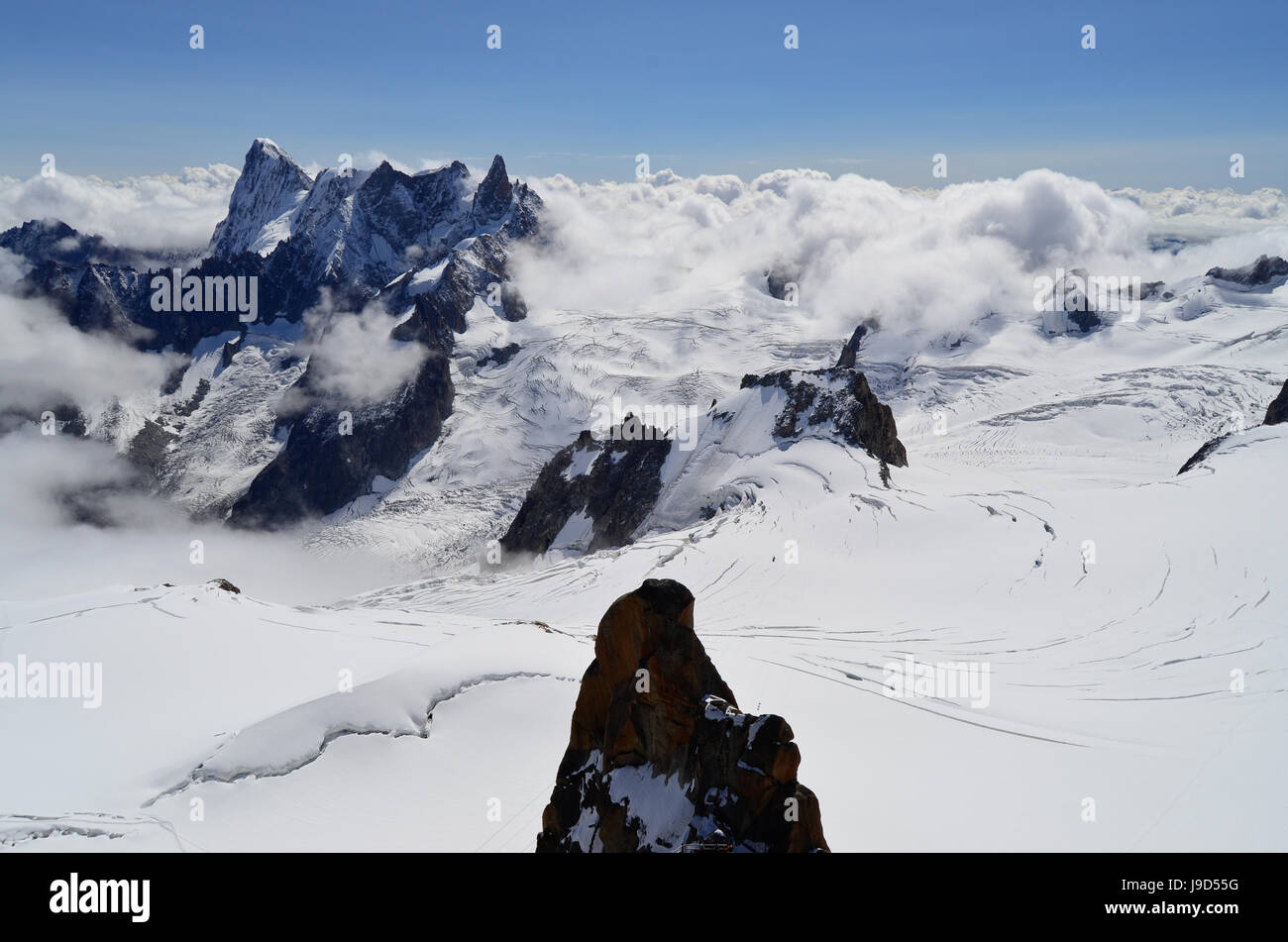 Snowy mountains above the clouds. View from the Aiguille du Midi	(France) Stock Photo