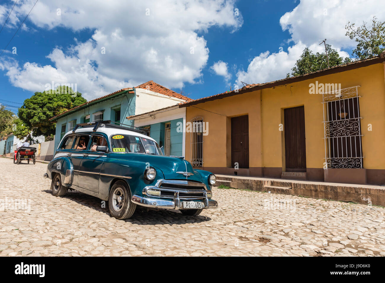 A vintage 1950's American car working as a taxi in the town of Trinidad, UNESCO, Cuba, West Indies, Caribbean - Stock Image
