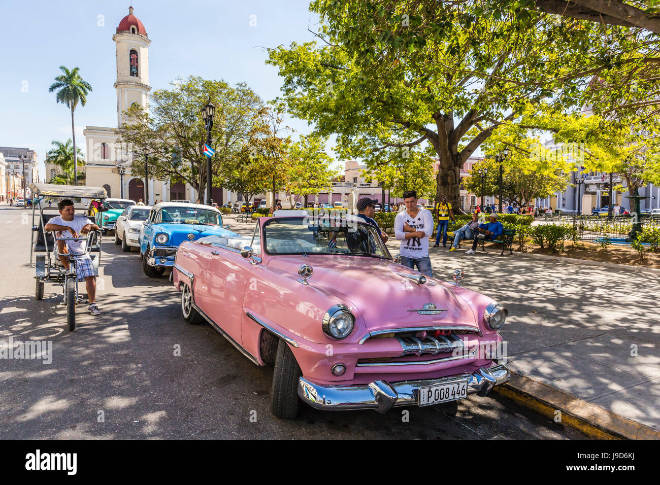 Classic 1950's Plymouth taxi, locally known as almendrones in the town of Cienfuegos, Cuba, West Indies, Caribbean - Stock Image