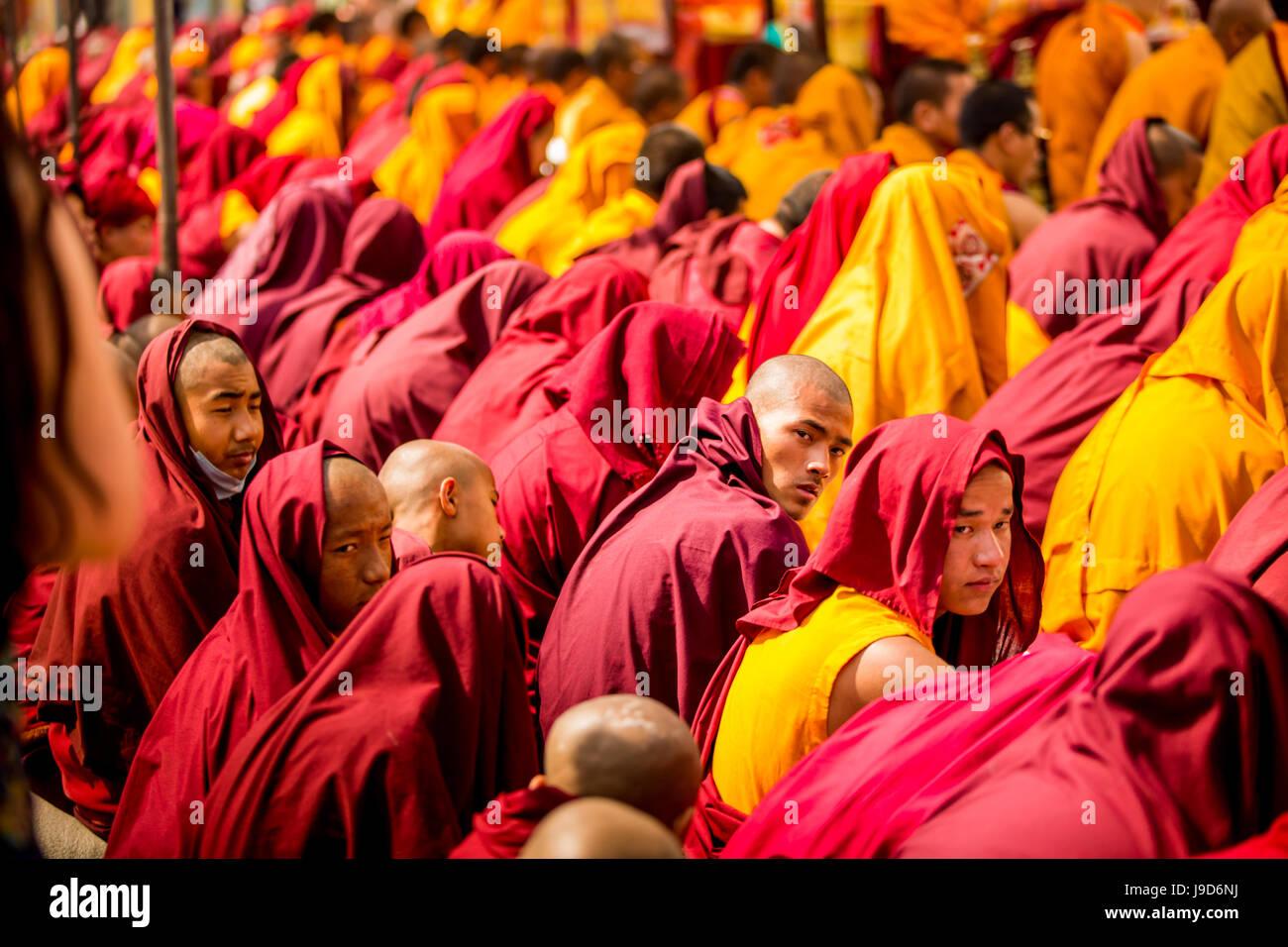 Buddhist Monks praying around temple at Bouddha (Bodhnath), Kathmandu, Nepal, Asia - Stock Image