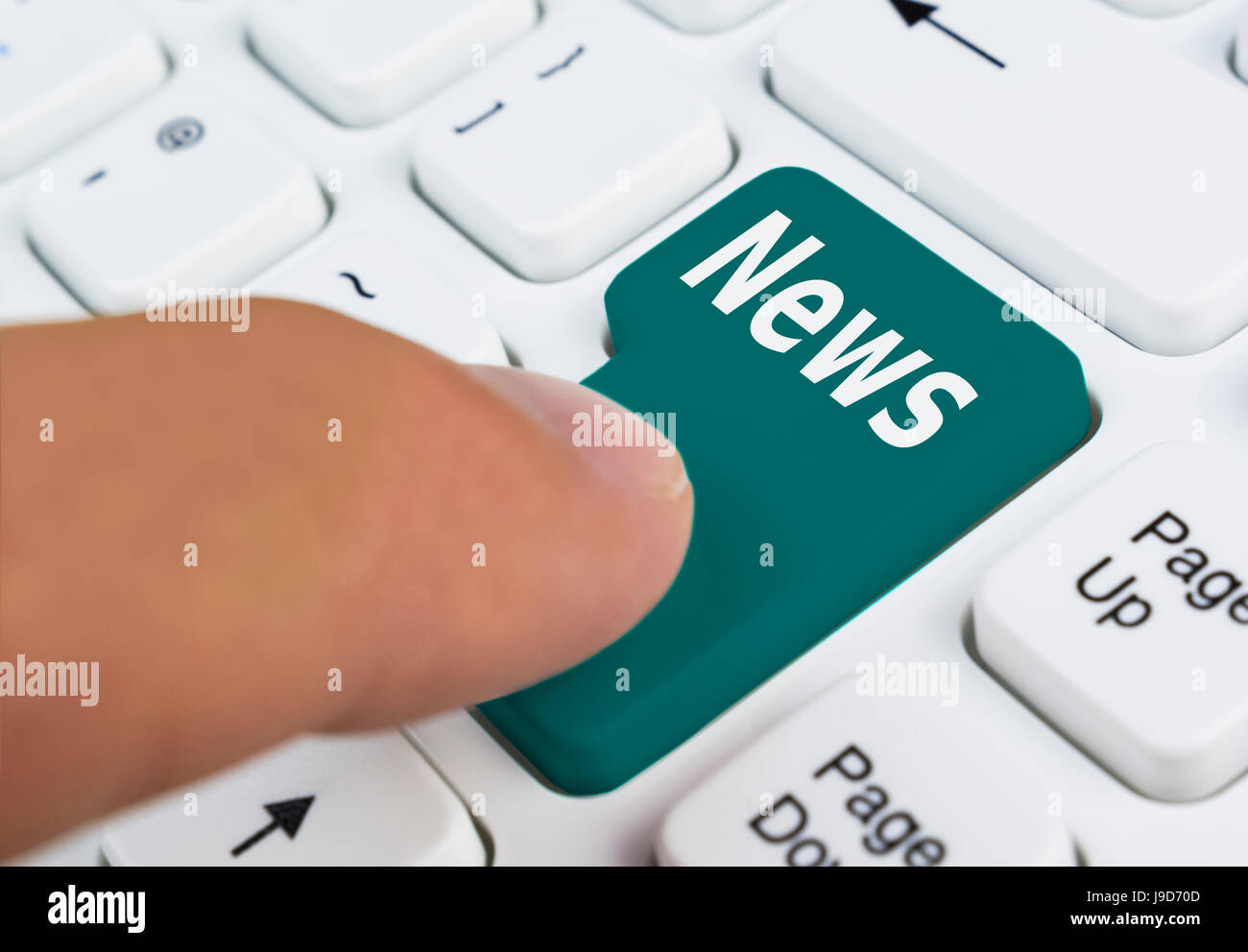 News concept. Pressing a news button on a computer keyboard. - Stock Image