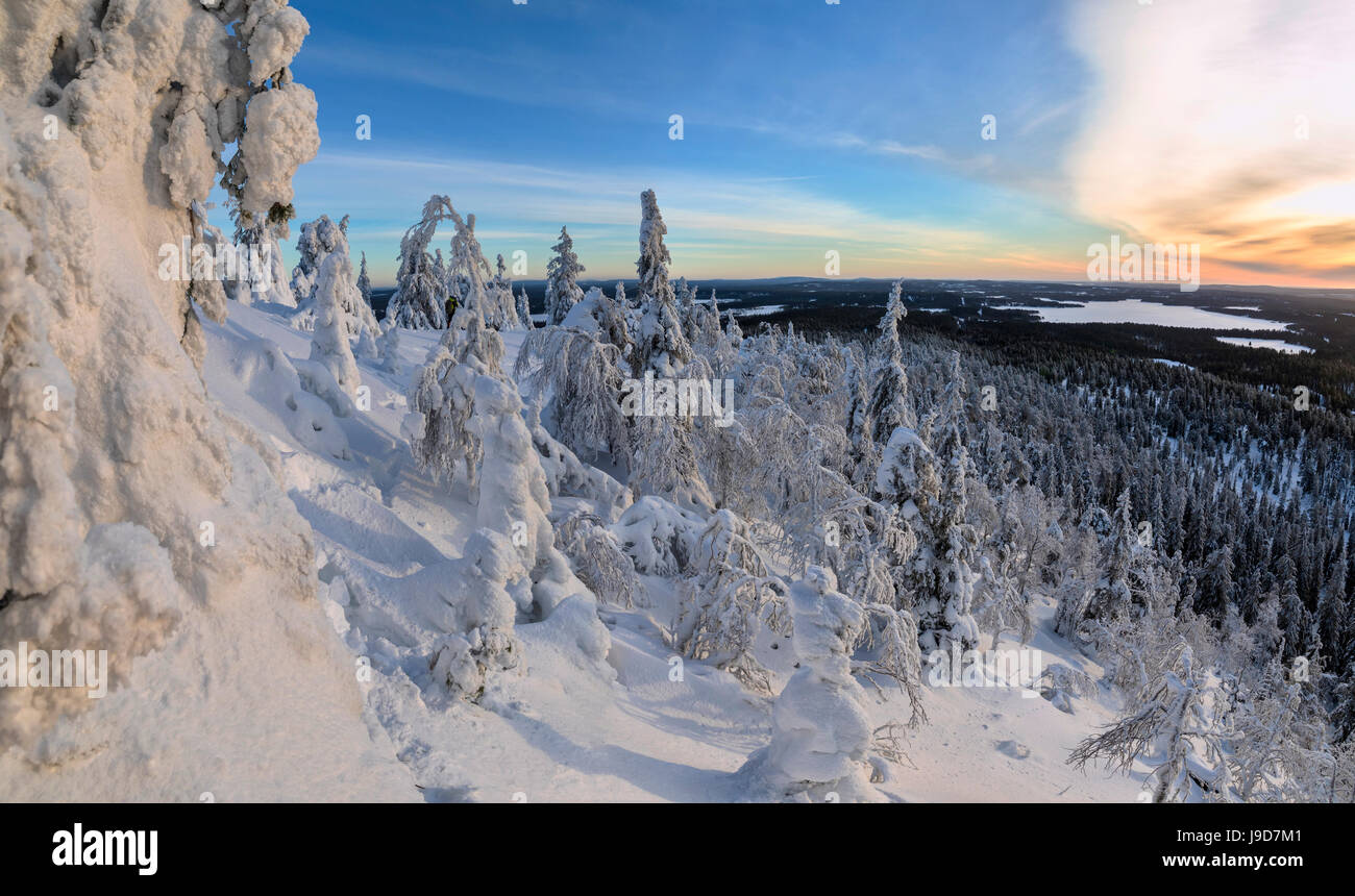 Panorama of snowy landscape and woods framed by blue sky and sun, Ruka, Kuusamo, Ostrobothnia region, Lapland, Finland, - Stock Image