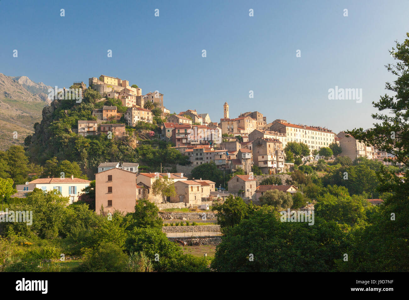The old citadel of Corte perched on the hill surrounded by mountains, Haute-Corse, Corsica, France, Europe - Stock Image