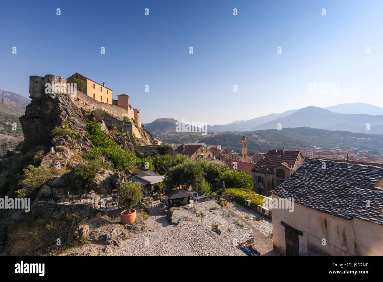 View of the old town of citadel of Corte perched on the hill surrounded by mountains, Haute-Corse, Corsica, France, - Stock Image