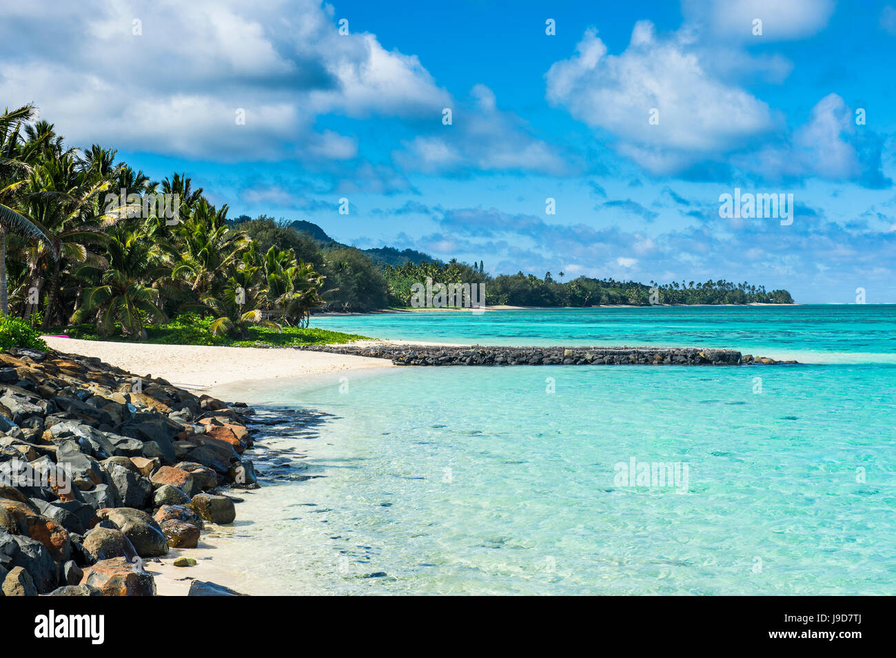 White sand beach and turquoise waters, Rarotonga and the Cook Islands, South Pacific, Pacific - Stock Image