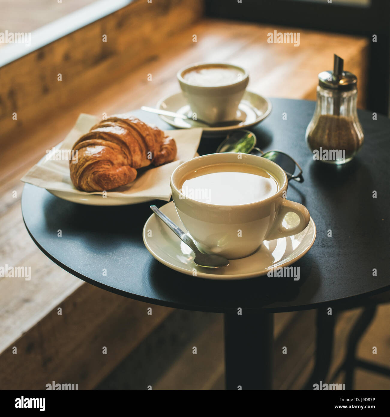 Coffee latte, cappuccino and croissant on table , square crop - Stock Image