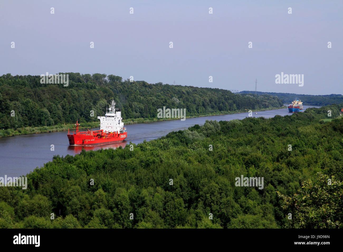 Freight Ships on Kiel Canal going near Hochdonn, Dithmarschen, Schleswig-Holstein, Germany, Europe - Stock Image