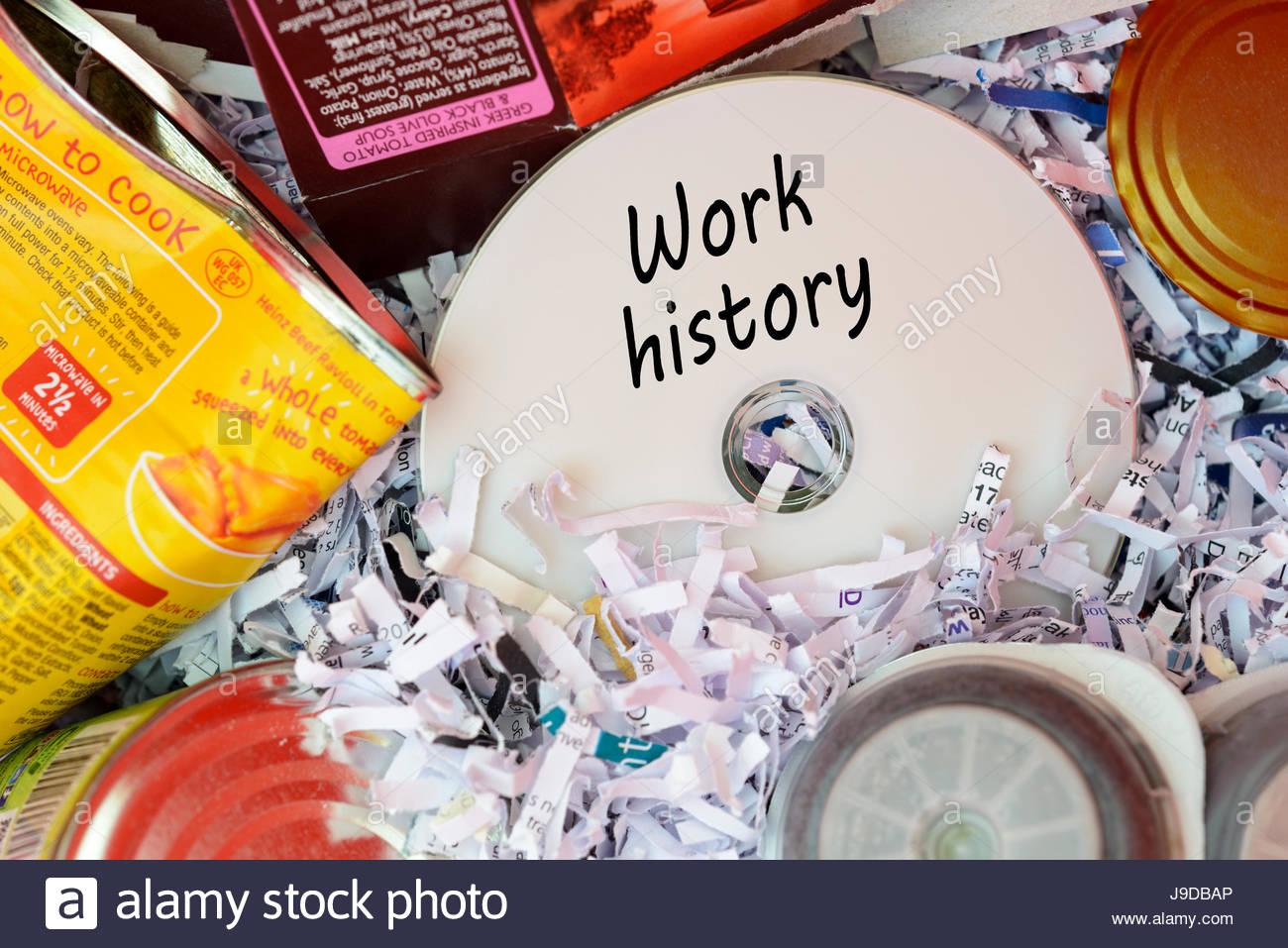 Work history, data disc thrown in Bin, Dorset, England. Stock Photo
