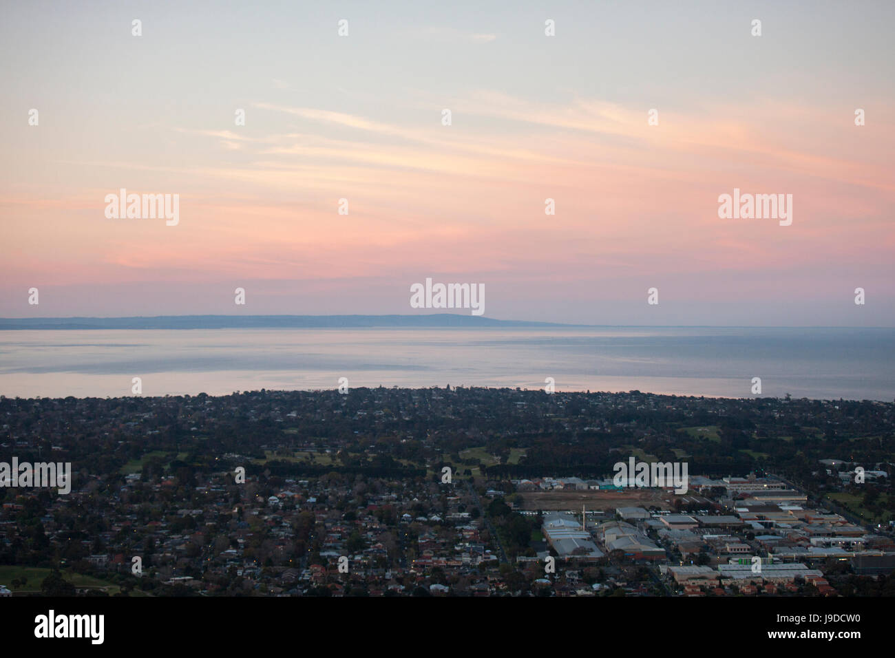 Aerial view of city in the dawn. - Stock Image