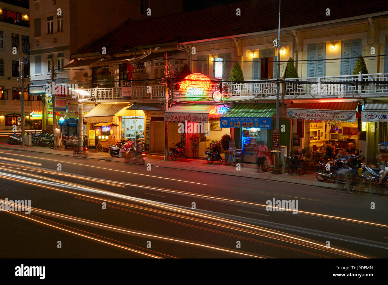 Shops and restaurants at night, Can Tho, Mekong Delta, Vietnam - Stock Image