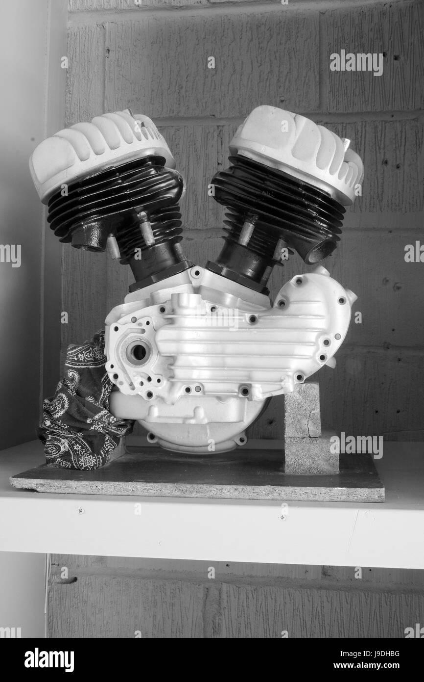 A V-Twin engine on a shelf - Stock Image