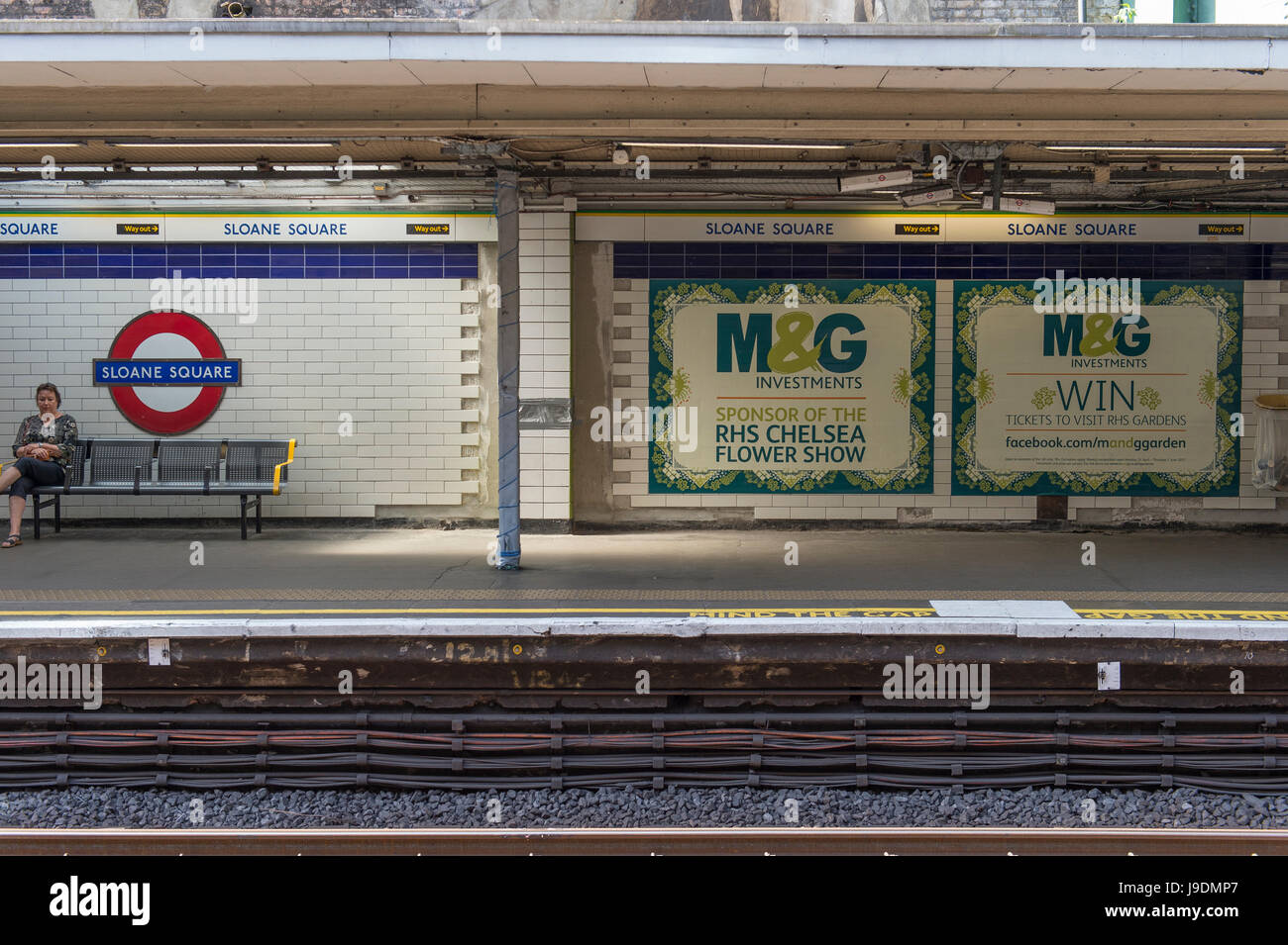 M&G Investments posters at Sloane Square underground station, sponsors of the RHS Chelsea Flower Show - Stock Image
