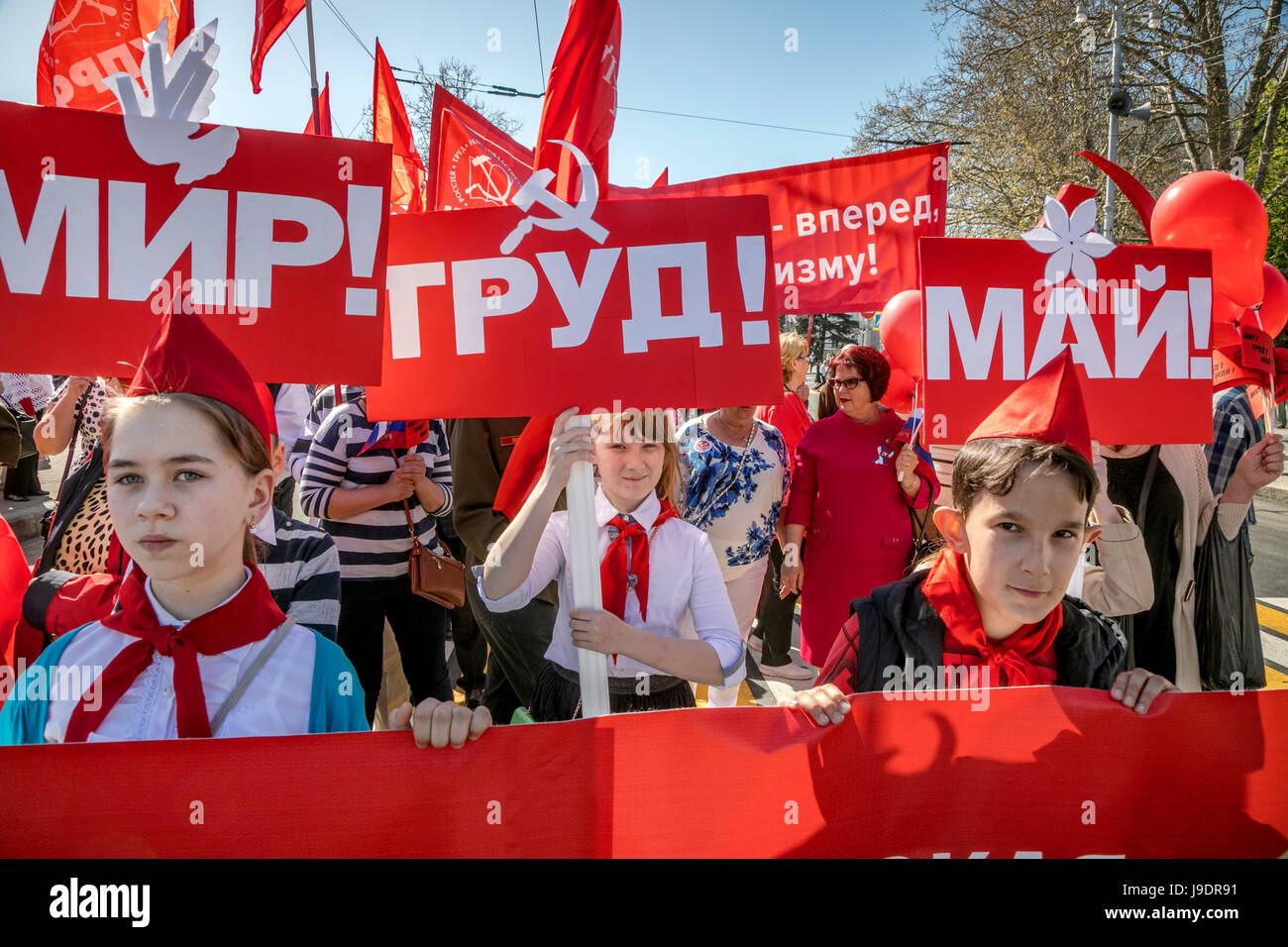 Participants in the May Day procession of the Communist Party on the International Workers' Solidarity Day along - Stock Image