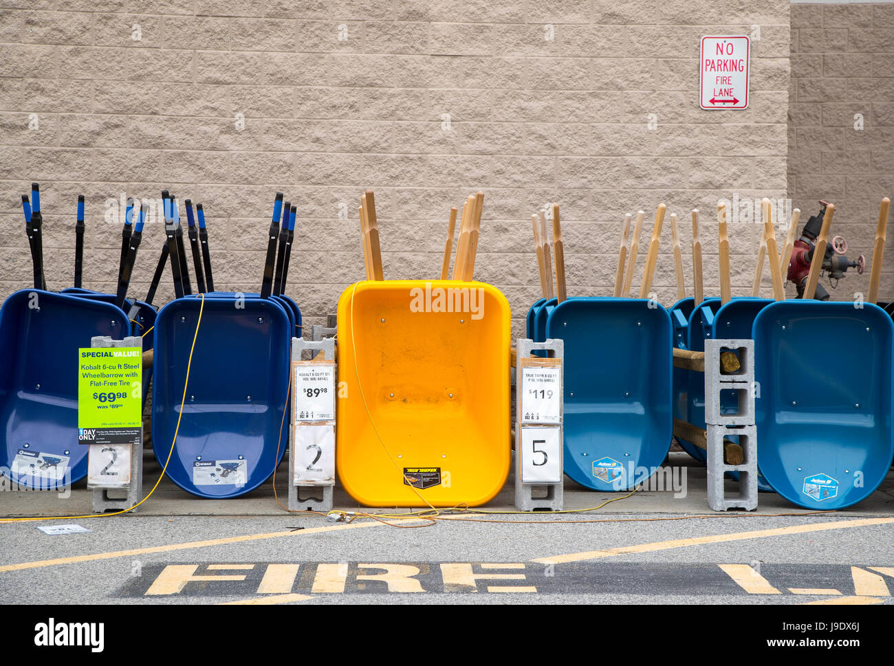 Wheelbarrows at a Lowe's home improvement store in Monroe, New York - Stock Image
