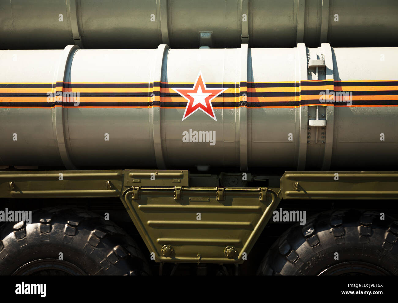 Russian army background: rocket launcher decorated with St. George ribbon and a star symbol. Missile system vehicle - Stock Image