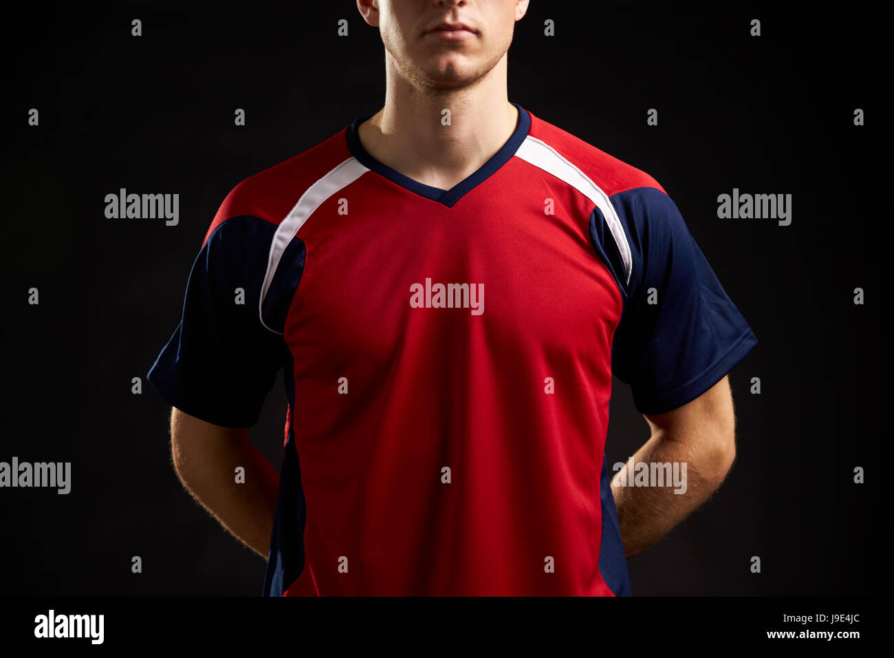 Close Up Of Professional Soccer Player In Studio - Stock Image