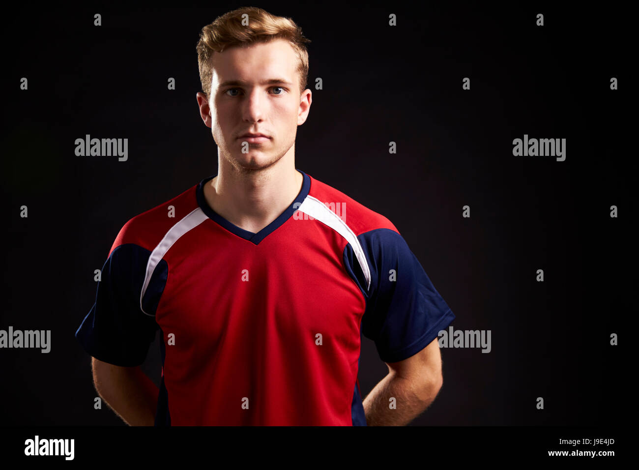 Portrait Of Professional Soccer Player In Studio - Stock Image