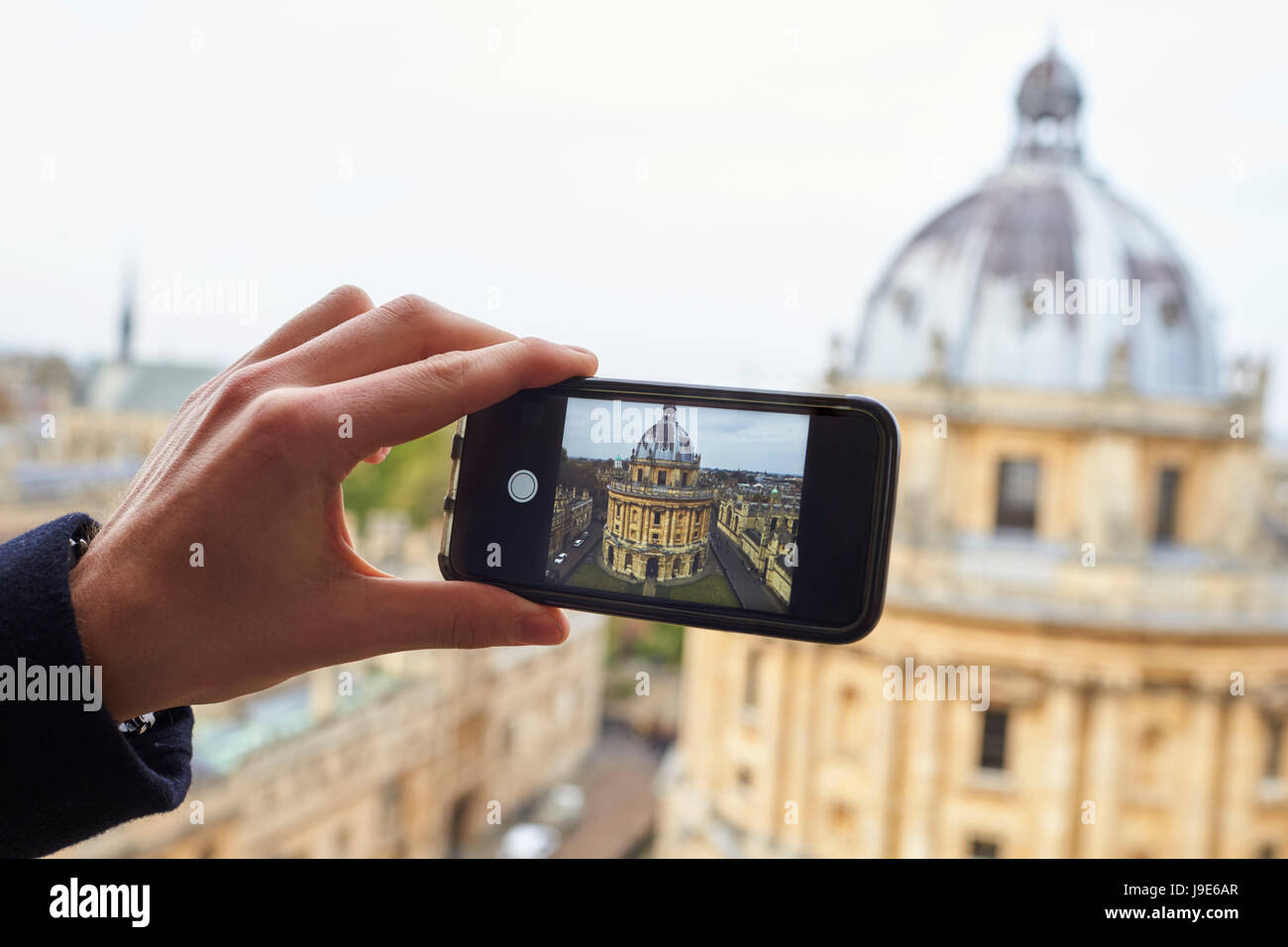 OXFORD/ UK- OCTOBER 26 2016: Tourist Taking Photo Of Radcliffe Camera In Oxford On Phone - Stock Image