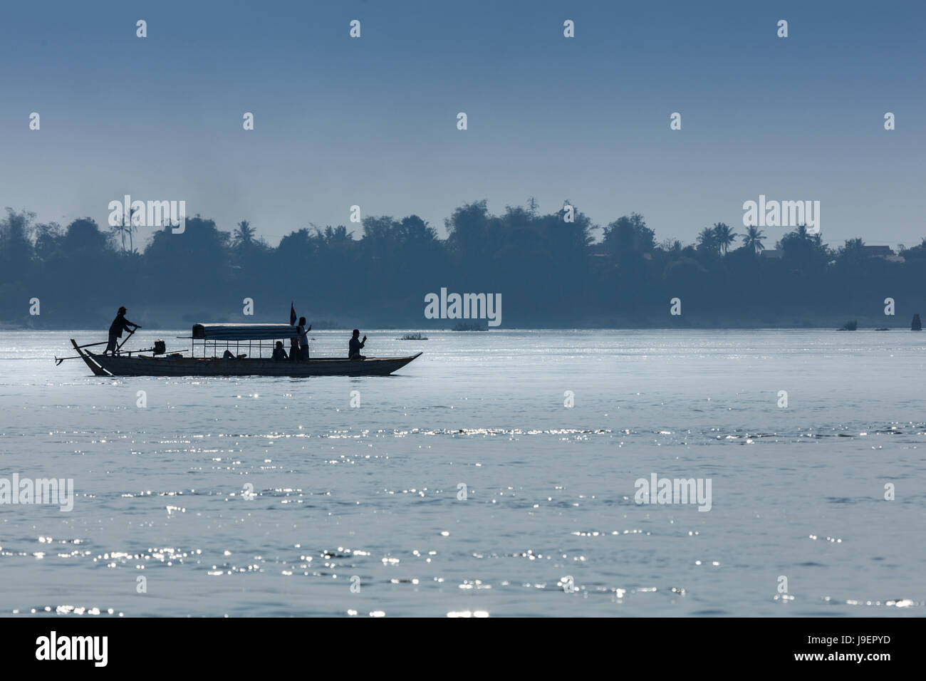 Tourist boat on the Mekong river looking for Irrawaddy River Dolphins near Kratie - Stock Image