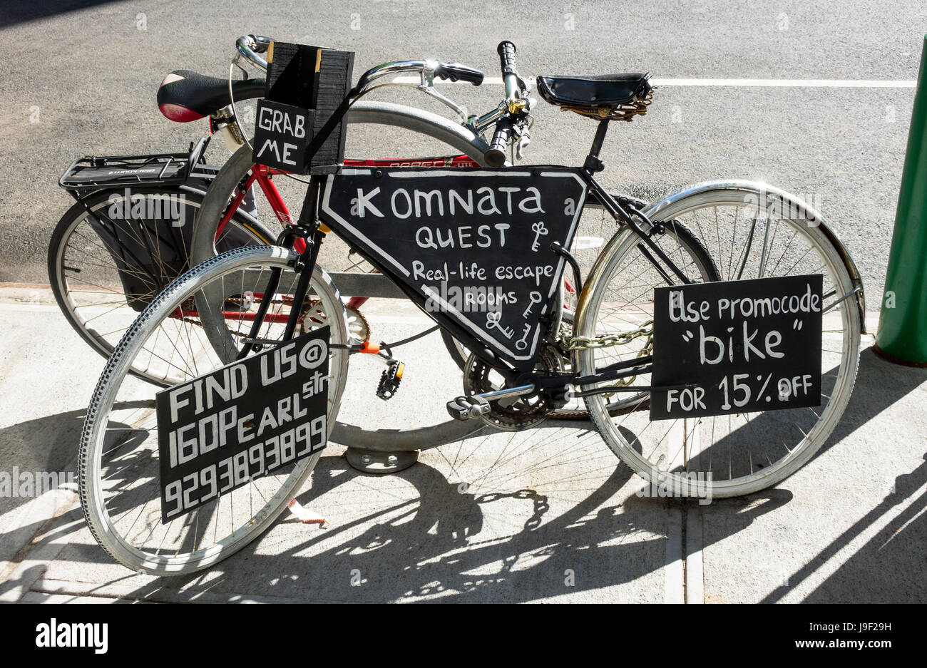 A bicycle with several ads attached - Stock Image