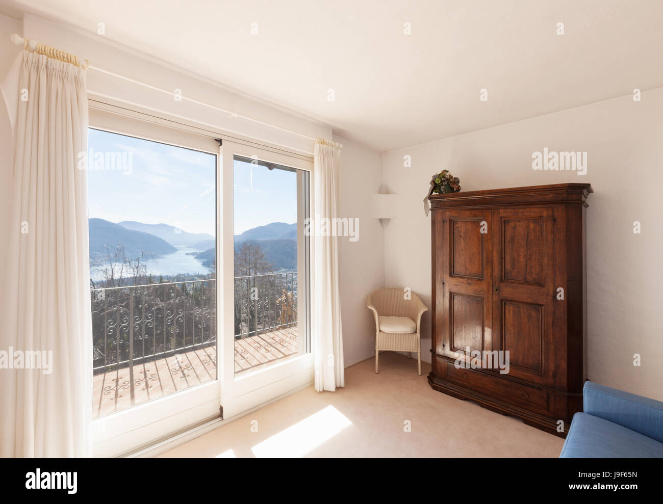 Small white room with beautiful landscape of Lugano - Stock Image