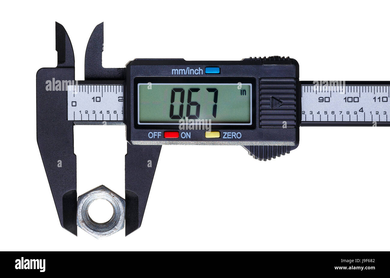 The digital caliper measures the diameter of the old nut. Objects isolated on white background. - Stock Image