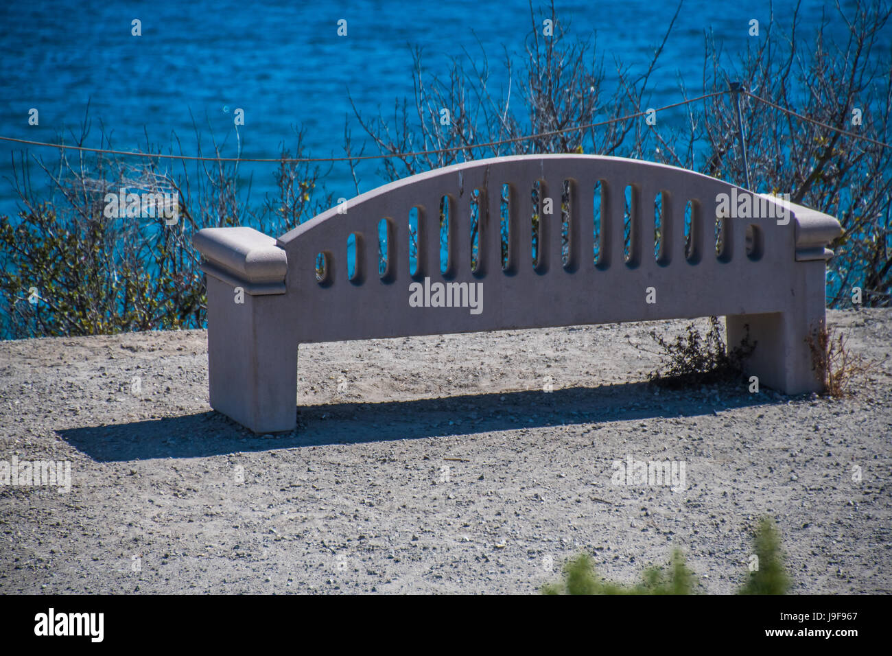 Bench by the sea - Stock Image