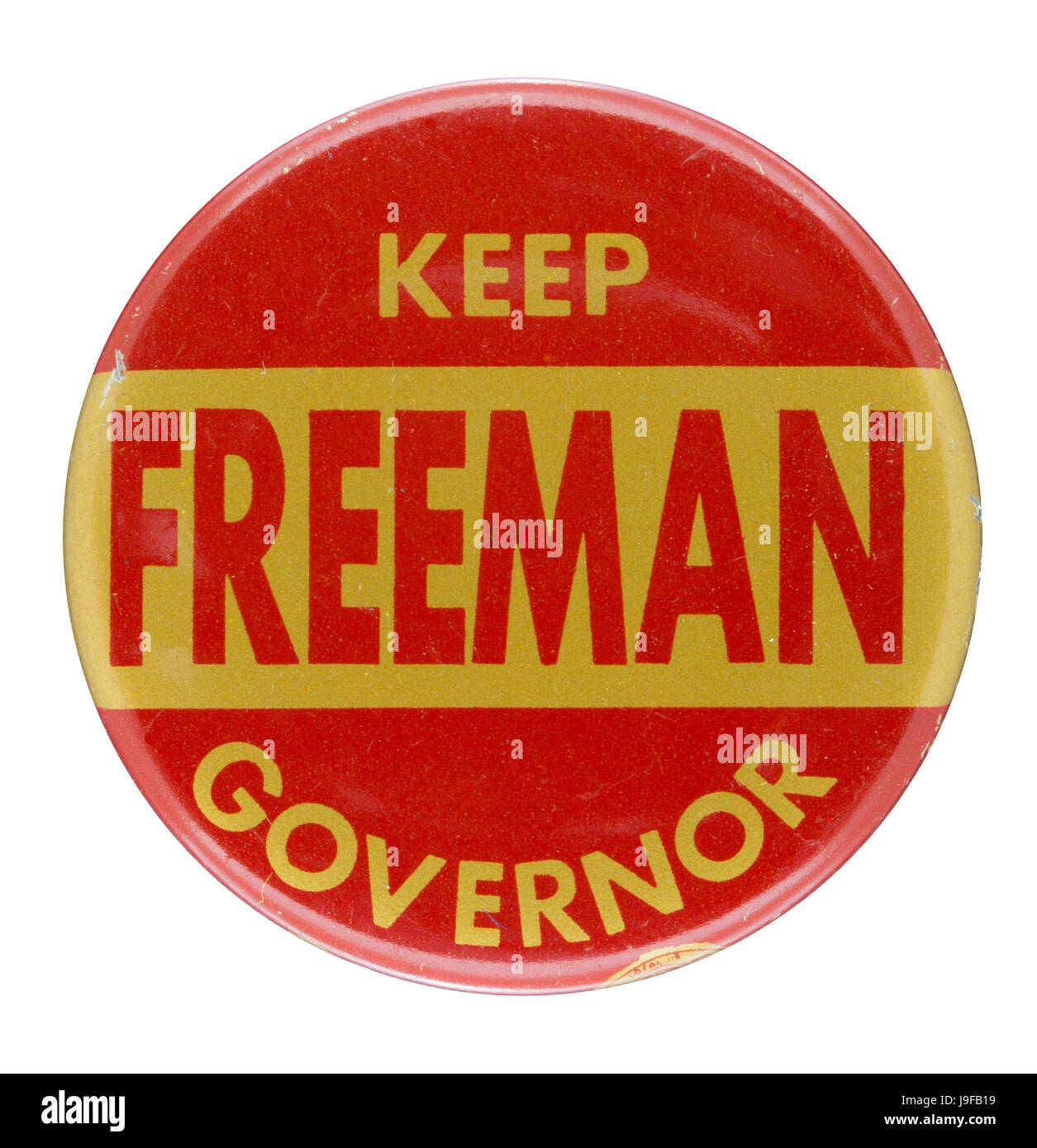 "A 1956-1960 Minnesota maroon and gold Orville Freeman re-election button, ""Keep Freeman Governor"" - Stock Image"