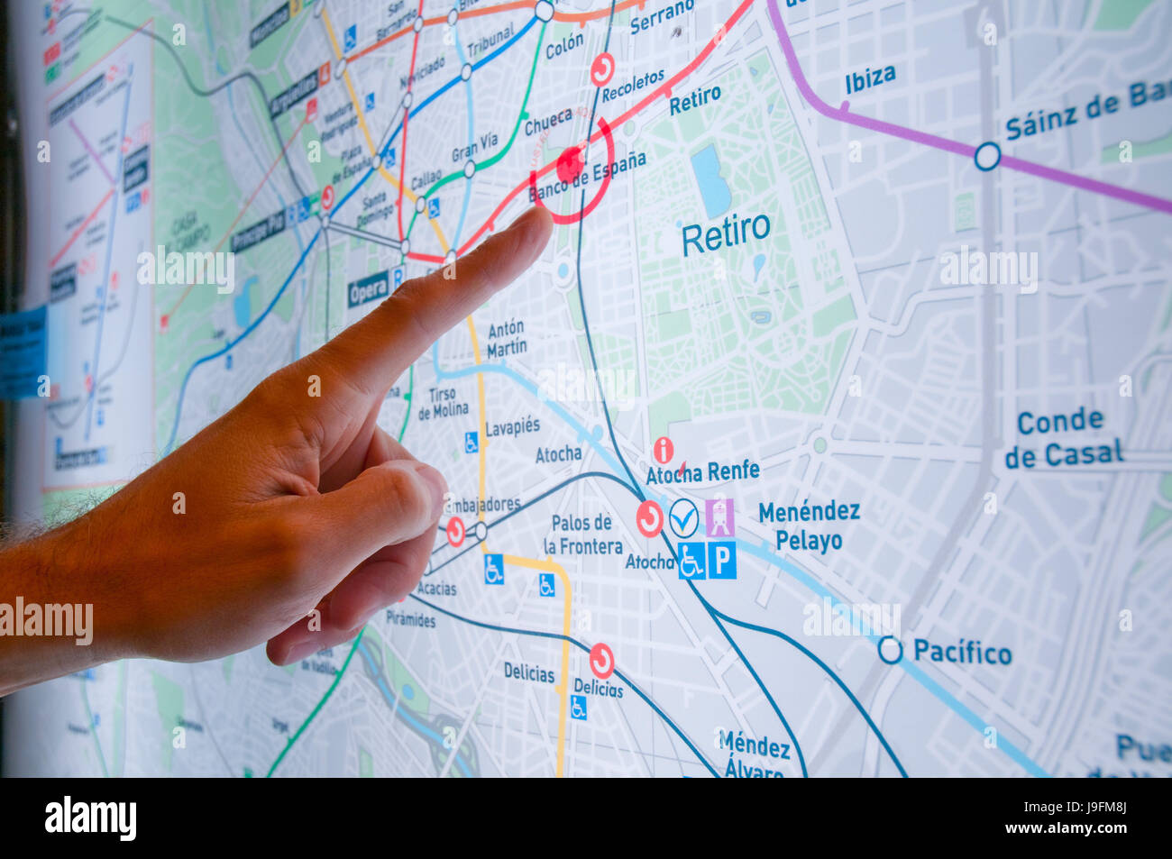 Man\'s hand pointing at a point on a Metro map. Madrid, Spain Stock ...