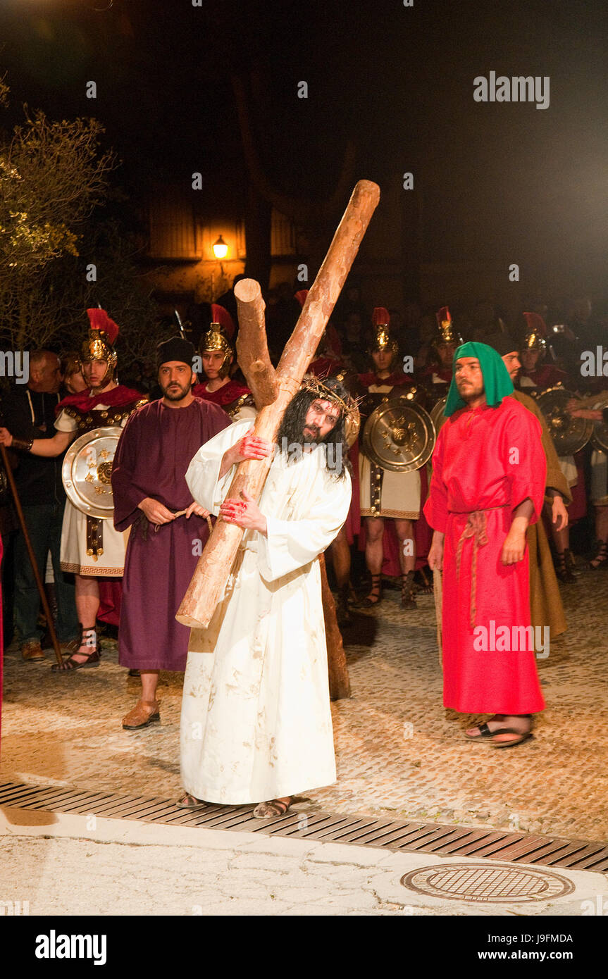 Jesus carrying the cross in his way  to Calvary. Passion of Chinchon, Madrid province, Spain. Stock Photo