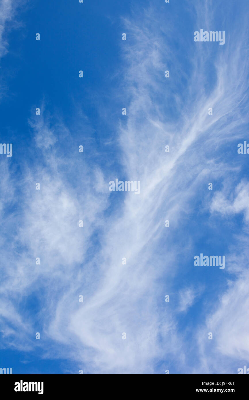 a blue sky background image with white cloud in summer - Stock Image